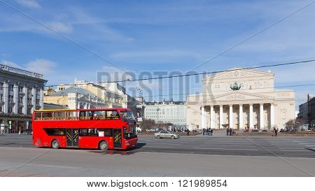 Moscow - March 13 2016: Red two-storey tourist bus and the State Academic Bolshoi Theatre of Russia and tourists from the theater March 13 2016 Moscow Russia