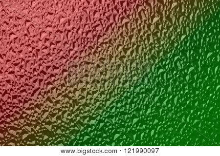 Corrugated glass surface tinted yellow and red color photo