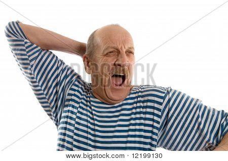 Elderly  Man In A Stripped Vest Yawns