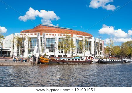 Amsterdam-April 30: Stopera with Dutch National Opera & Ballet on April 30 2015. The Stopera is a building complex housing both the city hall of Amsterdam and the Dutch National Opera & Ballet.