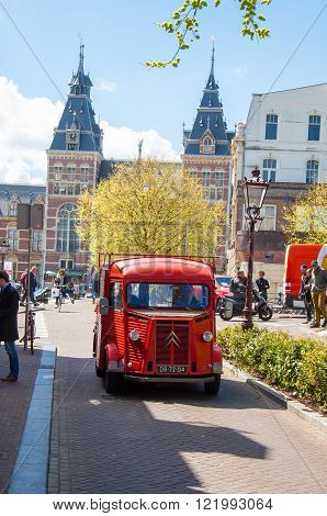 AMSTERDAM-APRIL 30: Citroen retro car on Amsterdam street the Rijksmuseum is visible in the background on April 30 2015 the Netherlands.