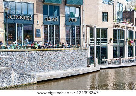 AMSTERDAM-APRIL 30: Undefined tourists have breakfast in Aran Irish Pub on April 302015 the Netherlands. Aran Irish Pub is a very relaxing and enjoyable place.