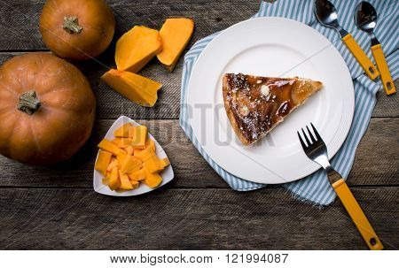 Rustic Style Pumpkin Slices And Piece Of Pie