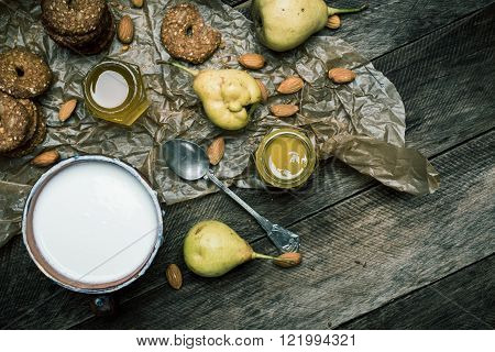 Almonds Pears Cookies And Cream On Rustic Wood