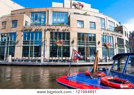 AMSTERDAM-APRIL 30: Famous Hard Rock Cafe on the Singelgrachtkering Canal on April 302015. Hard Rock Cafe Amsterdam offers an immersive experience in the waterside restaurant and cocktail bar.
