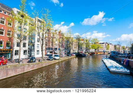AMSTERDAM-APRIL 30: The Prinsengracht canal (Prince's Canal) with row of boats on April 302015. Prinsengracht is the third of the three main canals: Herengracht Prinsengracht and Keizersgracht.