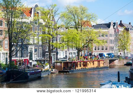 AMSTERDAM-APRIL 30: The Prinsengracht canal with houseboats on April 302015. Prinsengracht is the third and outermost of the three main canals: Herengracht Prinsengracht and Keizersgracht.