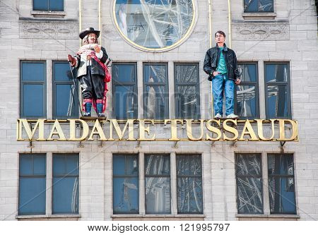 AMSTERDAM-APRIL 30, 2015: Madame Tussauds museum on Dam Square on April 302015 in Amsterdam. Madame Tussauds is a wax museum located on Dam Square in Amsterdam the Netherlands.
