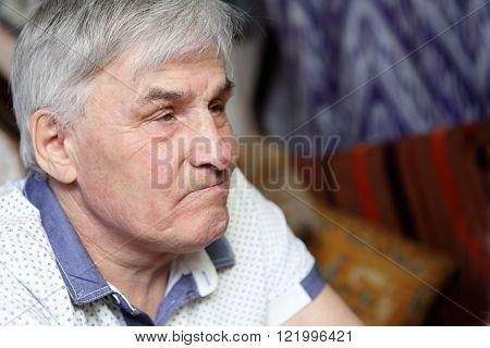 Portrait of a senior man in cafe