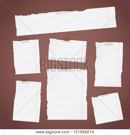 Pieces of torn white lined note paper with sticky tape on diagonal dark background