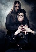 Romantic portrait of young gothic couple poster
