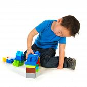 pic of physically handicapped  - Chinese boy with a light handicap is playing with colorful toys - JPG
