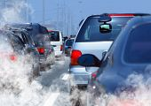image of car carrier  - pollution of environment by combustible gas of a car - JPG