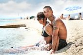 stock photo of woman beach  - Attractive couple relaxing on the beach - JPG
