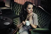 Gorgeous young lady drinking coffee