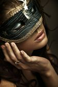 stock photo of masquerade mask  - Portrait of a young woman wearing mask - JPG