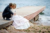 picture of wedding couple  - Romantic wedding couple at beach - JPG