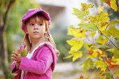 foto of children walking  - Funny fashion child walking in autumn park - JPG