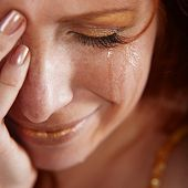 foto of insulting  - Closeup of crying woman with tears - JPG
