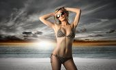 picture of woman bikini  - Portrait of a beautiful woman in bikini standing up on the beach - JPG