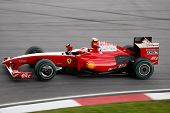 SEPANG - APRIL 4: Ferrari's Kimi Raikonnen practices at the 2009 F1 Petronas Malaysian Grand Prix on