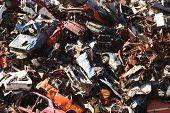 stock photo of junk-yard  - old rusting scrapped cars in a junk yard - JPG