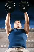 foto of lifting weight  - Very strong and handsome man lifting weights  - JPG