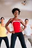 image of step aerobics  - Group of three people in colorful cloths in a gym doing step gymnastics - JPG