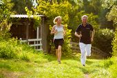 picture of summer fun  - Mature or senior couple doing sport outdoors - JPG