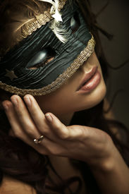 foto of masquerade mask  - Portrait of a young woman wearing mask - JPG