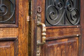 stock photo of front door  - this is an open door in old style - JPG