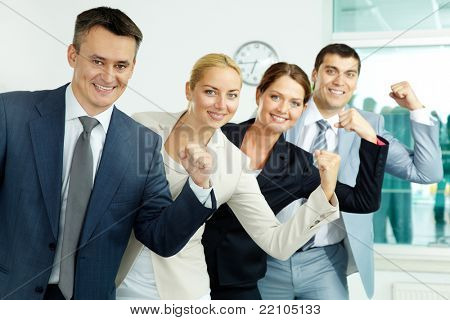 Portrait of business partners showing their strength with leader in front