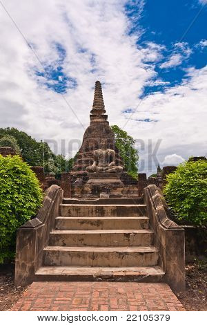 Buddha Statue In Front Of Pagoda In Sukhothai