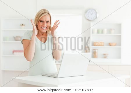 Upset woman looking into the camera in the kitchen