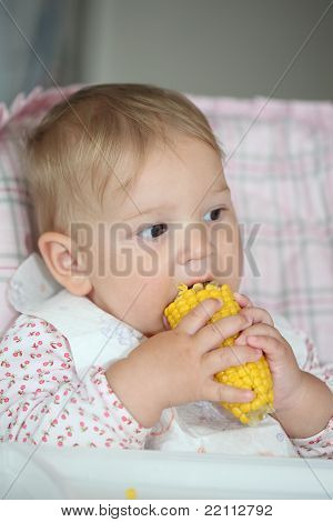 Baby Girl Eating Sweet Corn