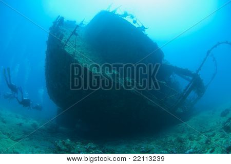 Scuba Divers On A Large Shipwreck