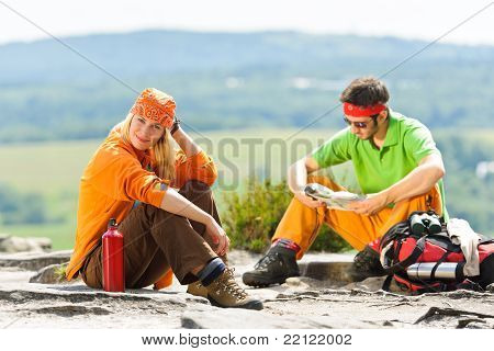 Hiking Young Couple Relax At Panoramic View