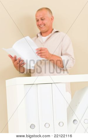 Casual Businessman Mature Stand Behind Bookshelf