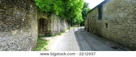 Old Stone Walls And Houses In Village In Rural England