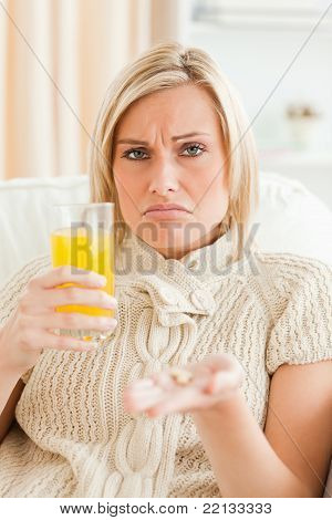 Sad Woman Showing Pills