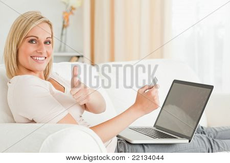 Smiling Woman Paying Her Bills Online