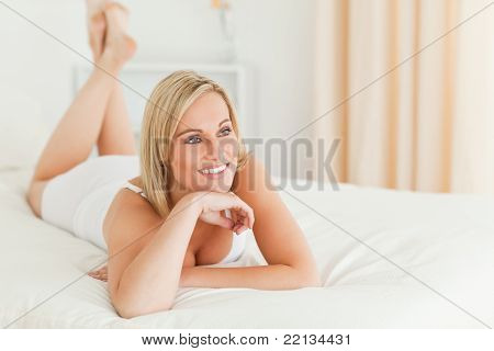 Close Up Of A Smiling Woman Lying On Her Bed