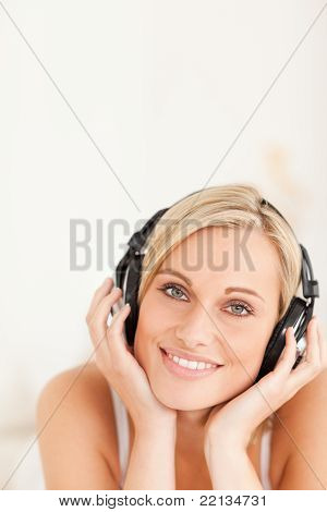 Portrait Of A Blonde Woman Wearing Headphones