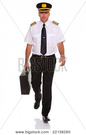 Photo of an airline pilot wearing the four bar Captains epaulettes walking towards camera carrying his flight case, isolated on a white background.