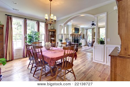 traditional furnished diningroom with pine floors