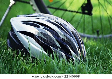 bicycle helmet on green grass - sport and leisure