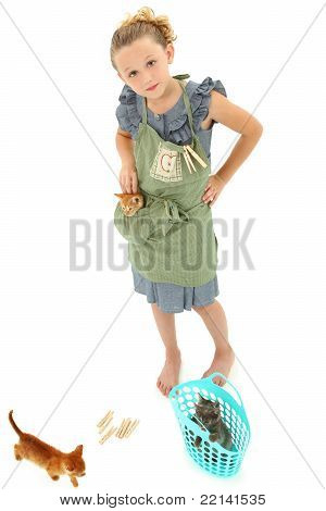 Adorable Girl Child In Apron Playing House With Kittens