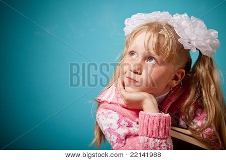 Portrait Of Confused Girl Holding Two Books