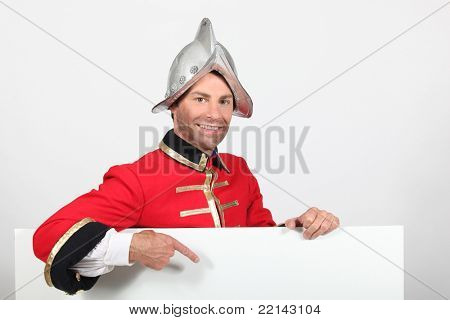 Man dressed as a soldier with a board left blank for your message