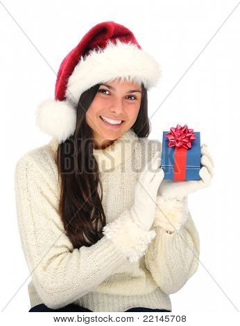 Closeup portrait of an attractive young woman wearing a Santa Claus Hat holding a small Christmas present next to her face. Vertical format isolated on white.